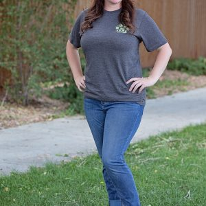 woman wearing a pub dog branded maroon baseball cap and charcoal tshirt front