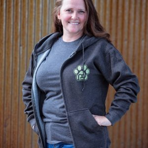 a woman wearing a pub dog branded zippered sweatshirt front