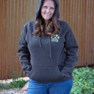 woman in a charcoal pub dog branded hooded sweatshirt